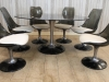 large industrial vintage round table with matching chairs