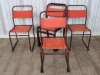 red frame stacking chairs