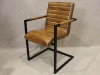 tan leather armchair with steel frame