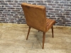 aged tan leather kitchen chair