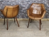 armchairs in tan leather