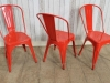 red stacking tolix style chairs