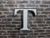 decorative letter t wall sign