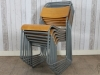 painted industrial stacking chairs