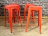 funky red stacking tolix style stool